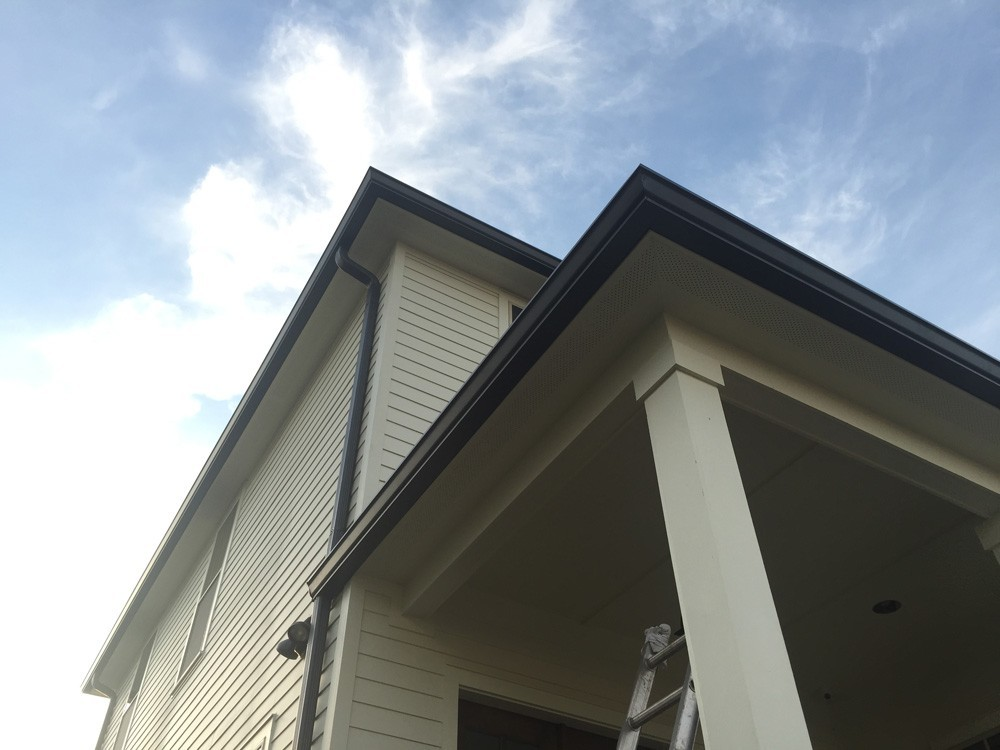 Brown Gutters on two story New Orleans home - Strong Shield