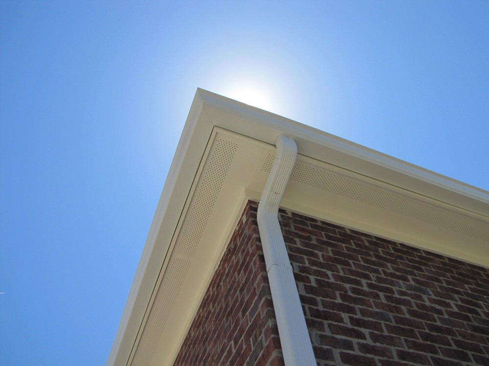 Gutters on traditional brick home in New Orleans - Strong Shield