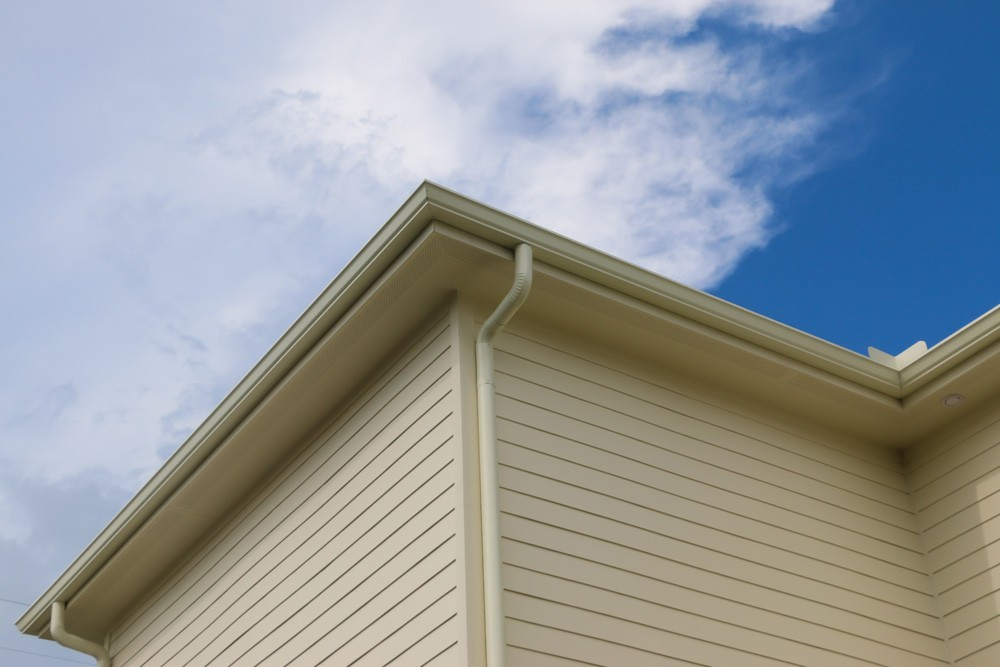 Tan round gutters in New Orleans - Strong Shield