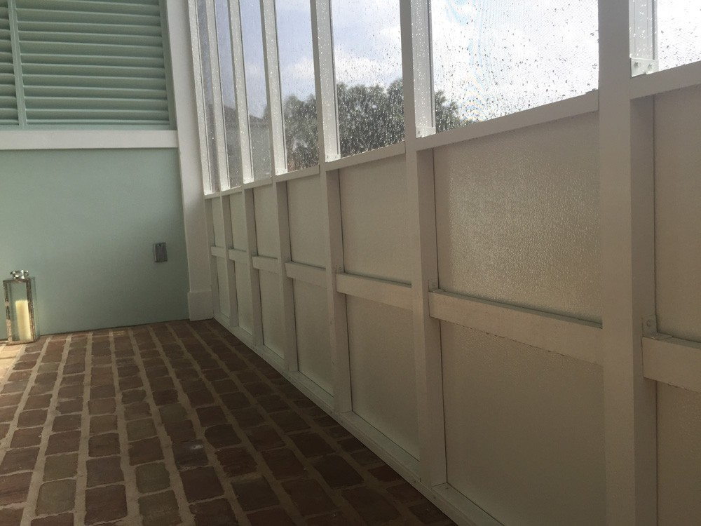 Patio enclosure inside New Orleans home - Strong Shield