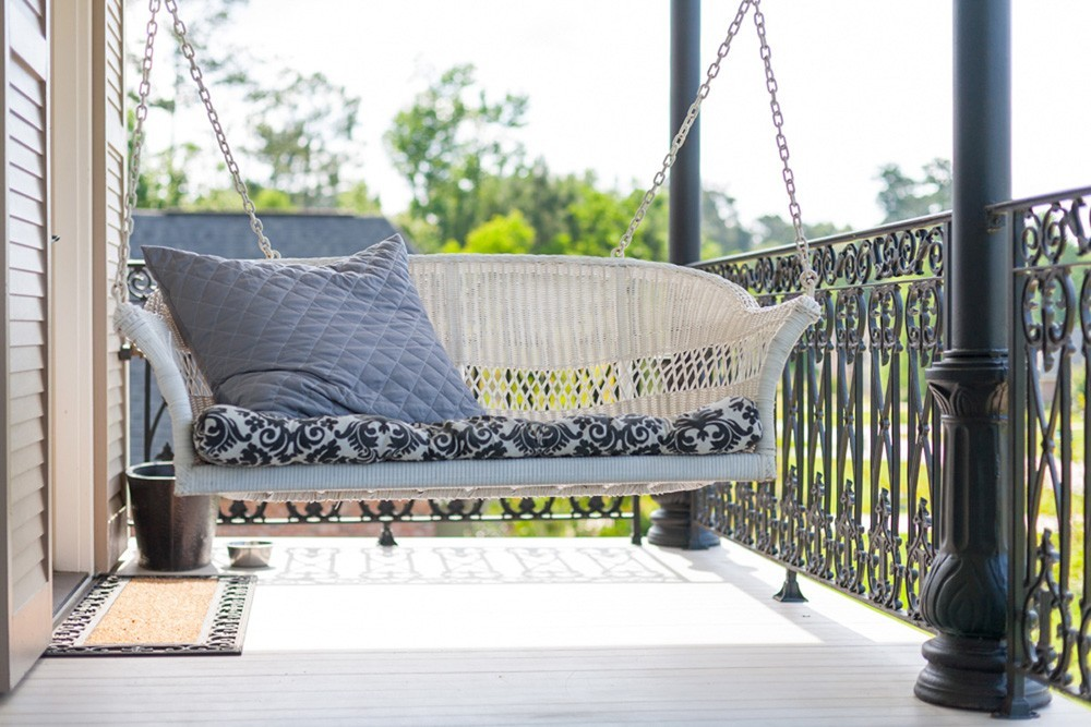 New Orleans porch with swing and iron railing - Strong Shield