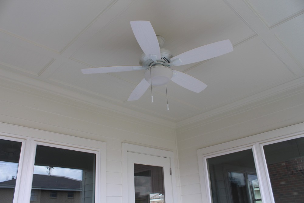 Custom trimmed porch ceiling with fan - Strong Shield