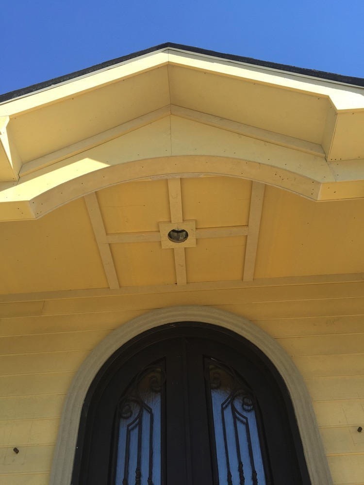 Porch ceiling above arched door in New Orleans - Strong Shield