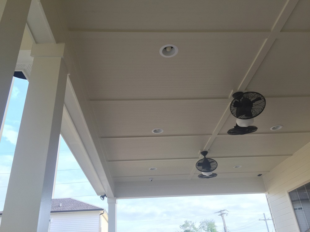Porch ceiling with bead board, trim, recessed lighting, and fans - Strong Shield