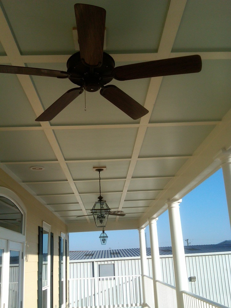Blue porch ceiling with white trim in New Orleans - Strong Shield