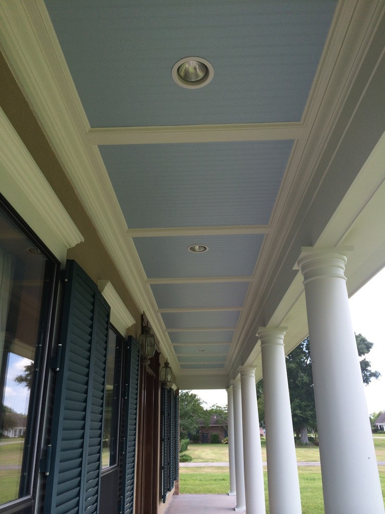 Blue bead board porch ceiling with white trim and columns in Metairie - Strong Shield