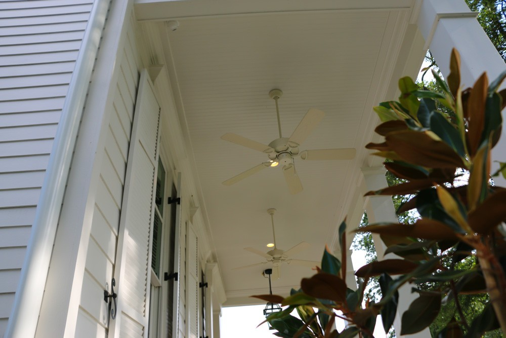 Tall white bead board New Orleans porch - Strong Shield