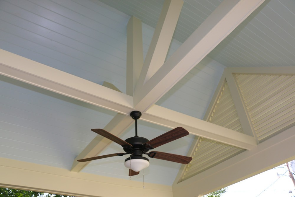 Pitched Metairie porch ceiling with wooden beams - Strong Shield