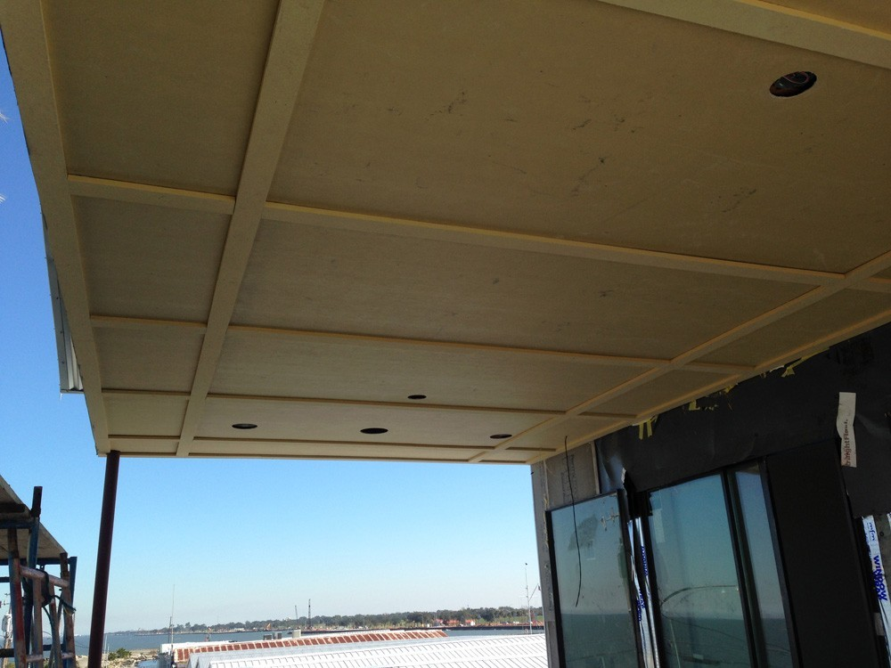 Waterfront porch ceiling with can lights - Strong Shield