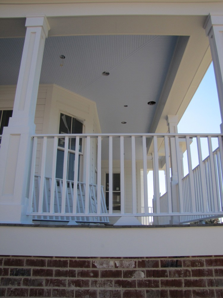 Wrap around porch with blue bead board ceiling - Strong Shield