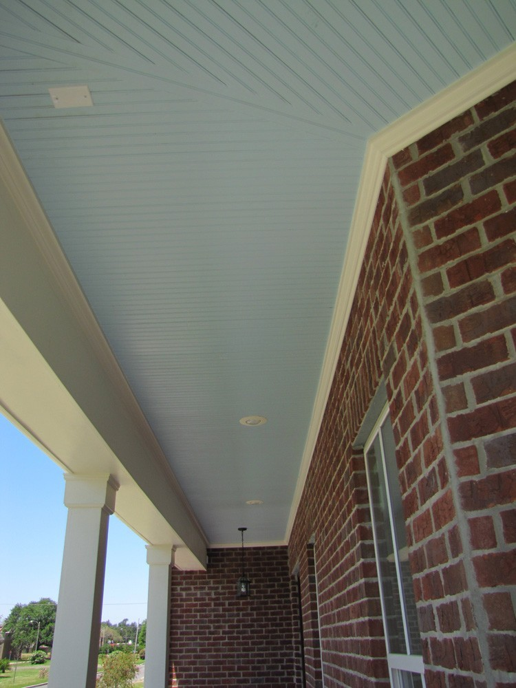 Blue bead board porch with white trim - Strong Shield