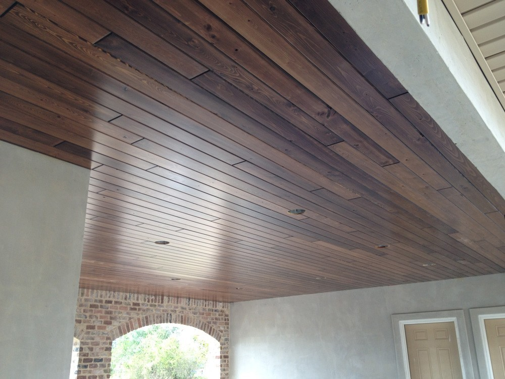 Wood porch ceiling with brick and stucco home - Strong Shield