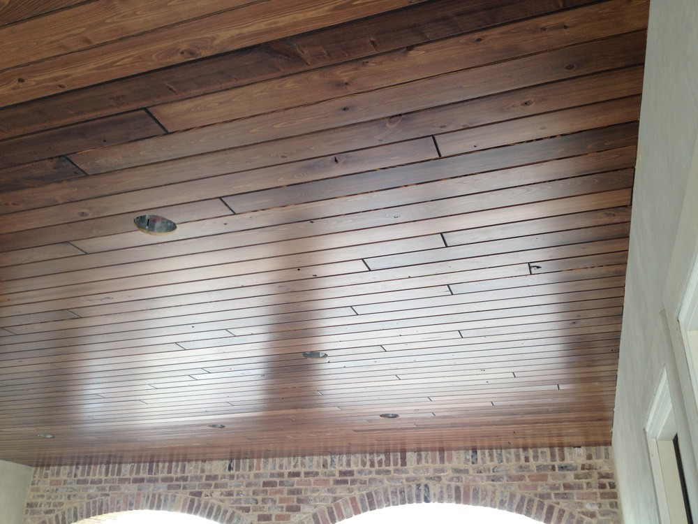 Metairie home with wood porch ceiling - Strong Shield