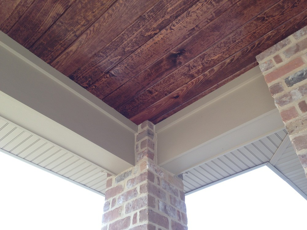 Wood porch ceiling with white trim and brick columns - Strong Shield
