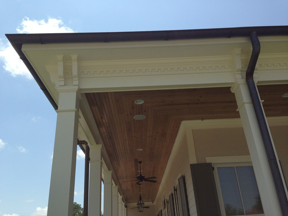 Wrap around porch with wood ceiling and dentil molding- Strong Shield