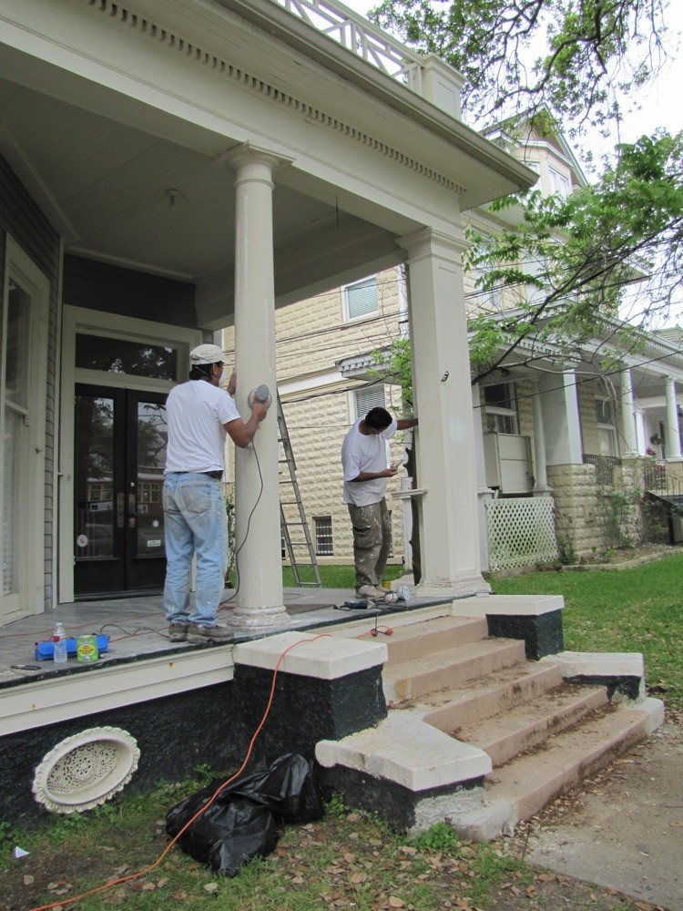 Sanding and repainting porch columns in New Orleans - Strong Shield