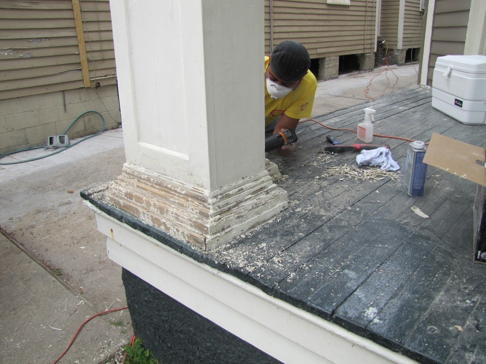 Sand and repaint porch columns and trim - Strong Shield