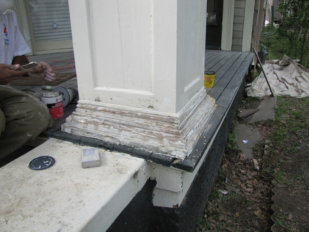 Repainting trim at base of columns - Strong Shield