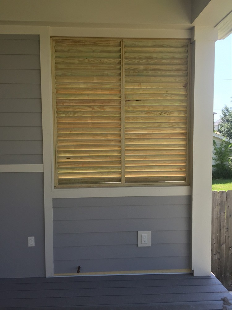 Wood shutters on porch - Strong Shield