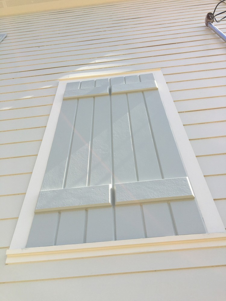 Custom wood shutters on New Orleans home - Strong Shield