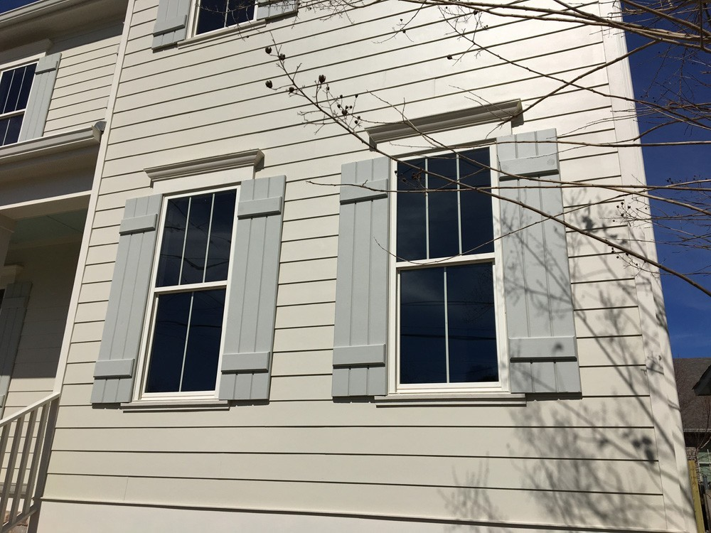 Custom shutters on windows with exterior trim - Strong Shield