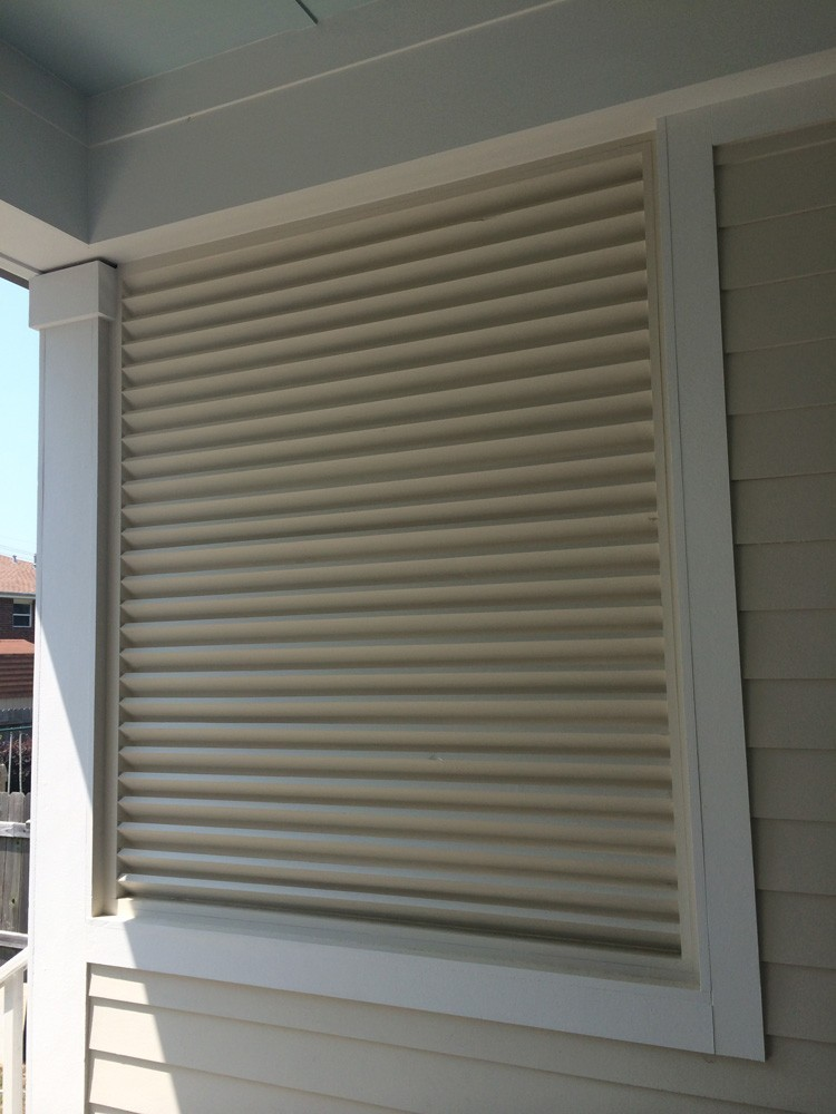 Shutters for covered patio in New Orleans - Strong Shield