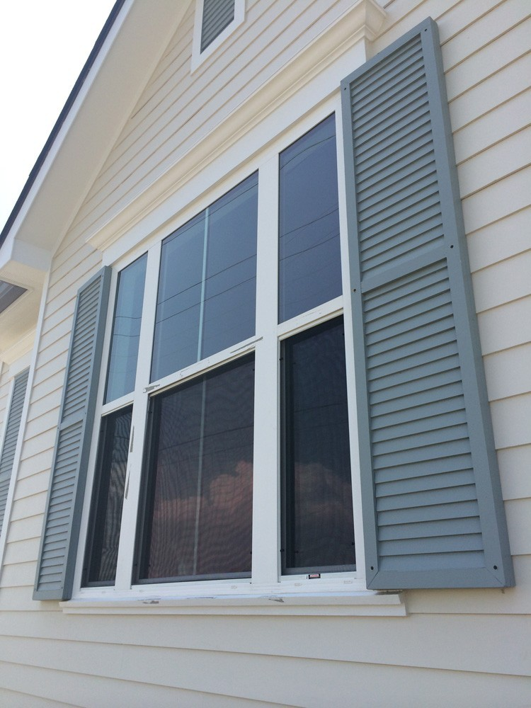 Green shutters on New Orleans home - Strong Shield