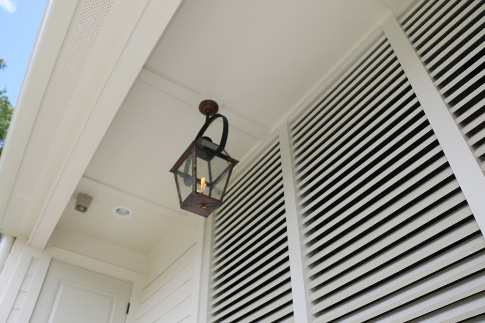 White shutters on porch with gas lantern - Strong Shield
