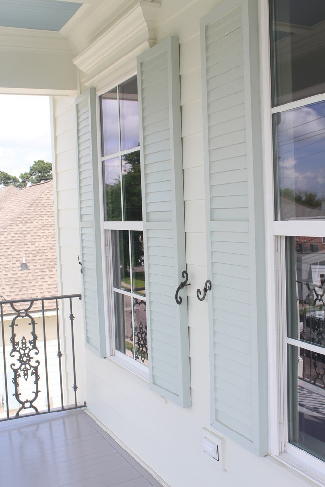 Light green shutters on white home - Strong Shield