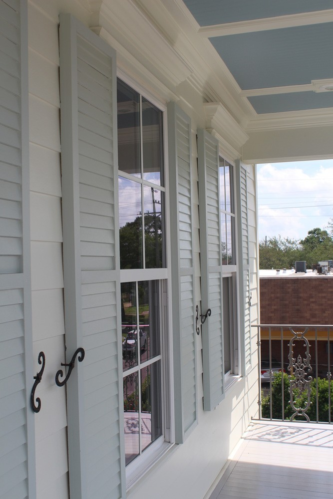 Shutters with wrought iron holdbacks - Strong Shield