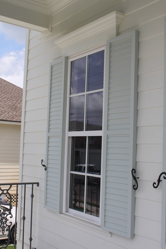 Traditional looking shutters with holdbacks in New Orleans - Strong Shield