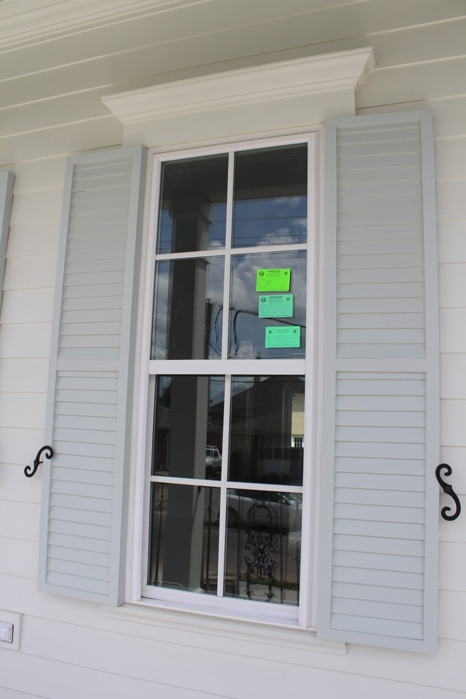 Shutter installation on New Orleans home - Strong Shield