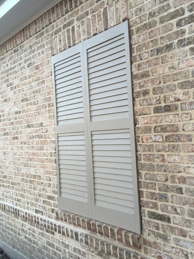 Tan shutters on brown brick with ivory buff mortar - Strong Shield
