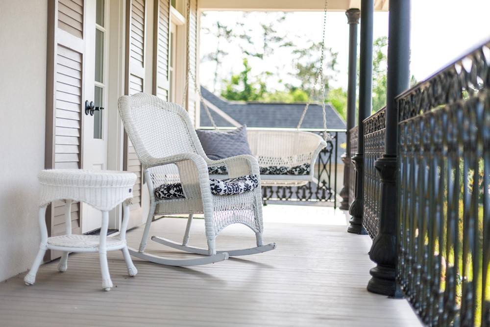 Tan shutters on light colored porch - Strong Shield