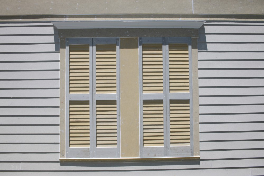 Double shutters on New Orleans home - Strong Shield