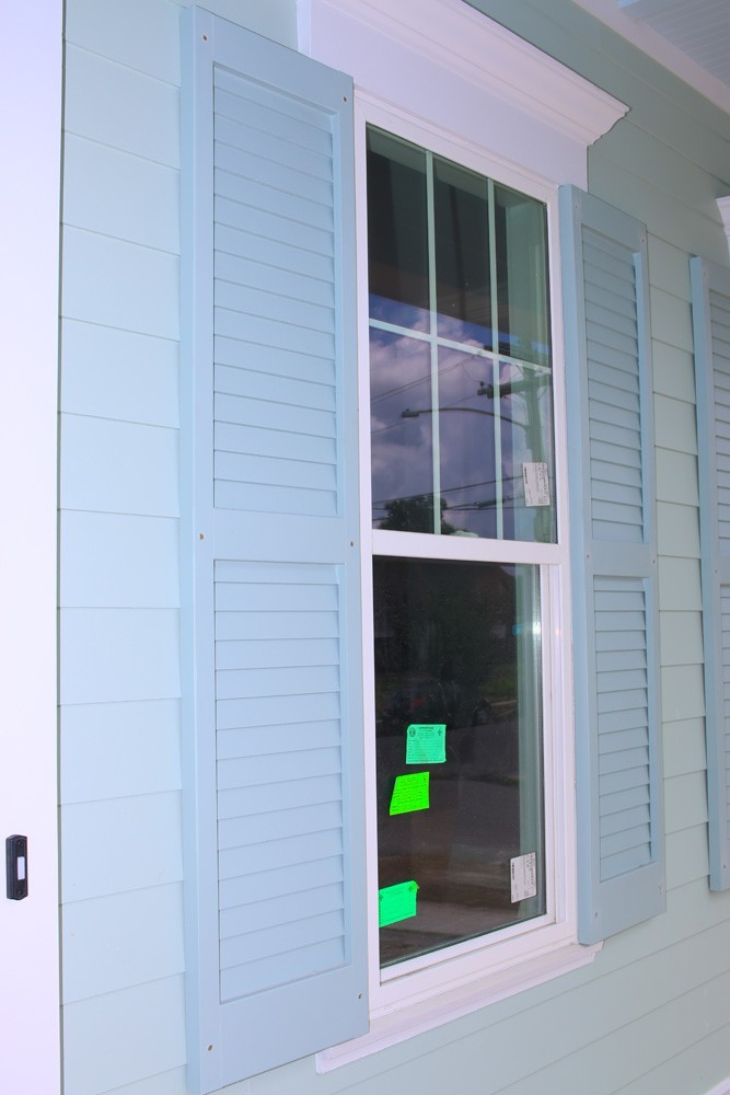 Blue shutters on New Orleans home - Strong Shield