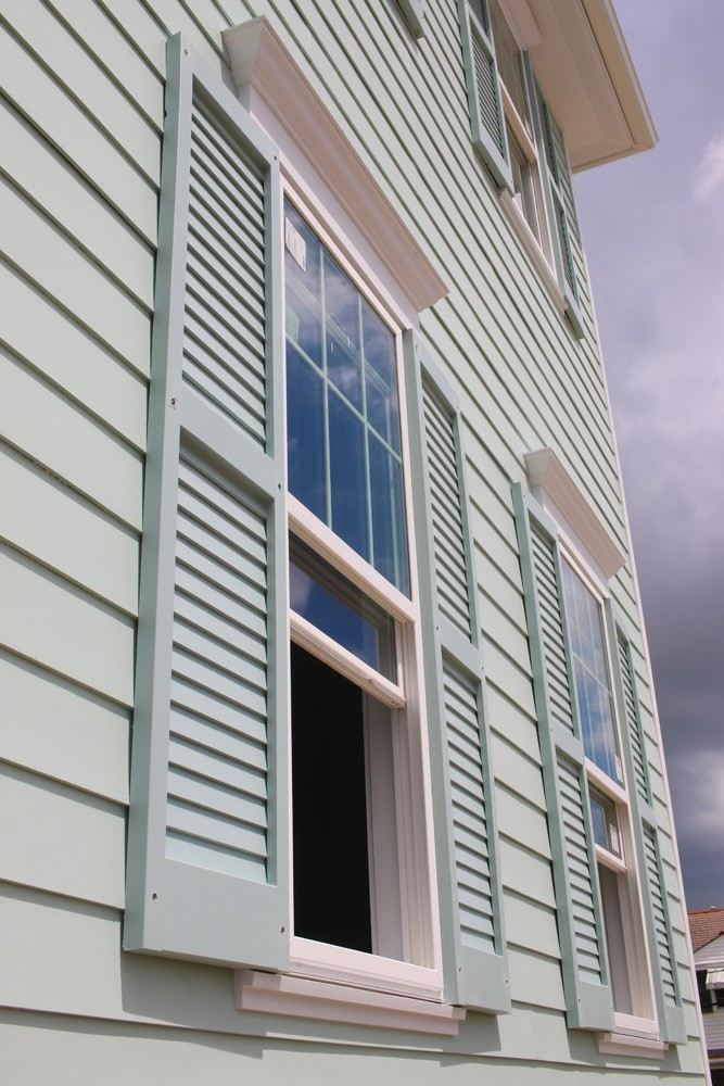 Shutters on home with green siding - Strong Shield