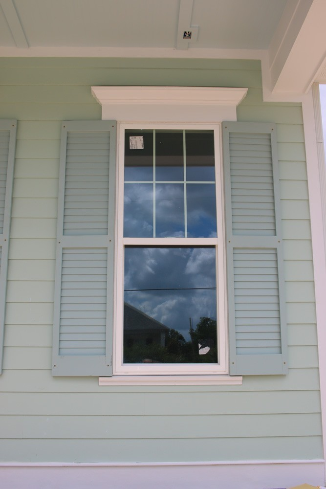 Shutters on light green New Orleans home - Strong Shield