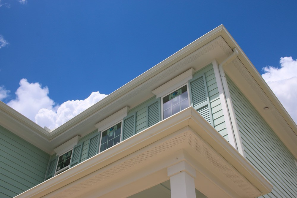 Green shutters on green two story home - Strong Shield