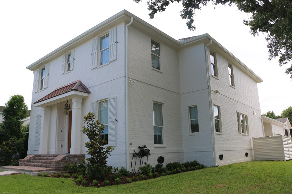 White shutters on white New Orleans home - Strong shield