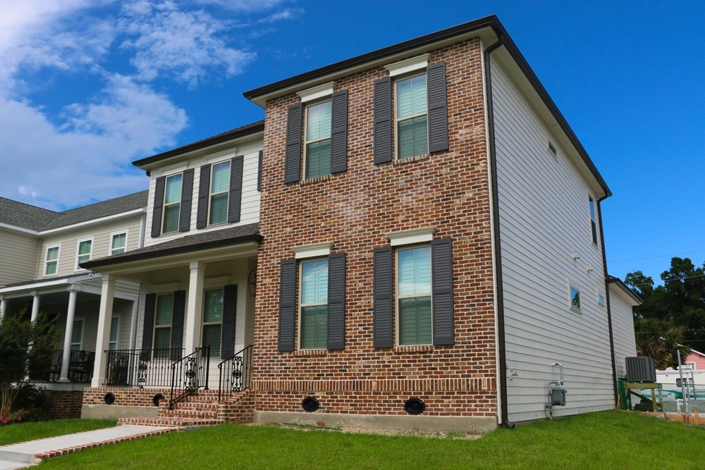 Shutters for red brick two story home - Strong Shield