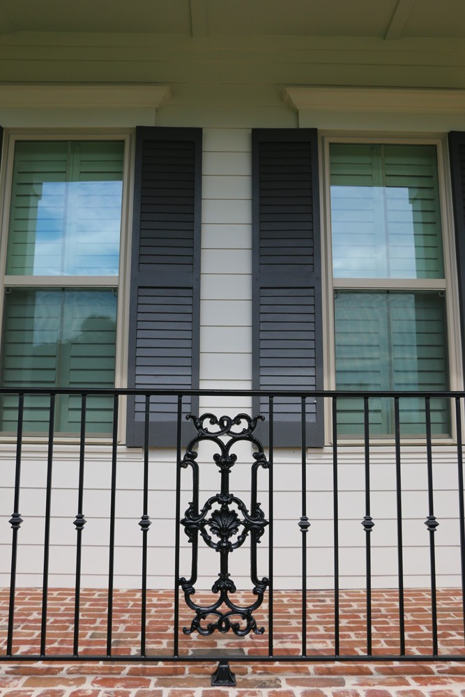 Shutters on white hardie siding in New Orleans - Strong Shield