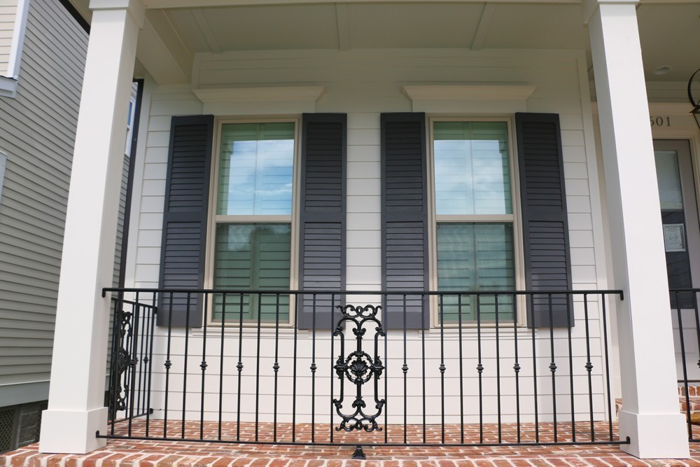 Light navy shutters on white siding - Strong Shield
