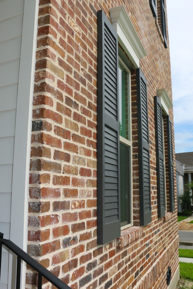 Shutters for red brick with white window trim - Strong Shield