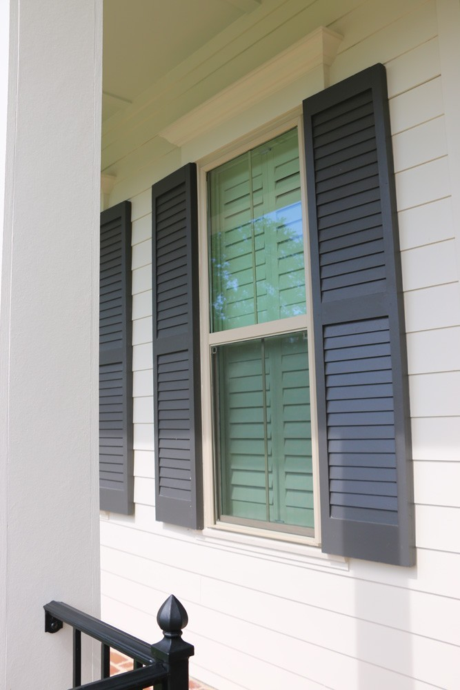 Shutters on New Orleans home with white hardie siding - Strong Shield