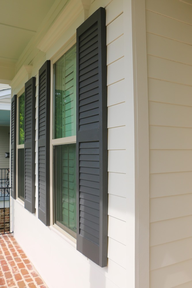 Louver style shutters on New Orleans home - Strong Shield