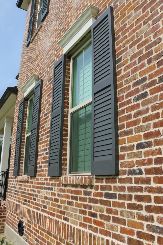 New Orleans home with wood shutters - Strong Shield