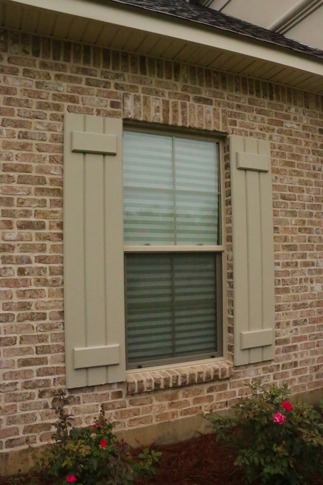 Board and batten shutters on Metairie home - Strong Shield
