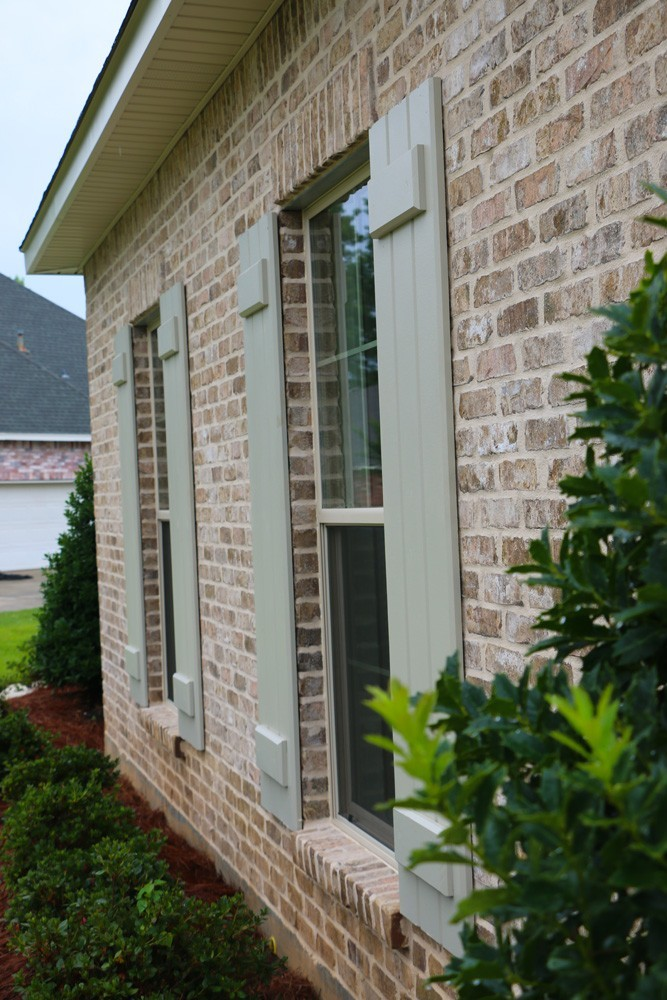 board and batten shutters on red brick house shutters new orleans strong shield