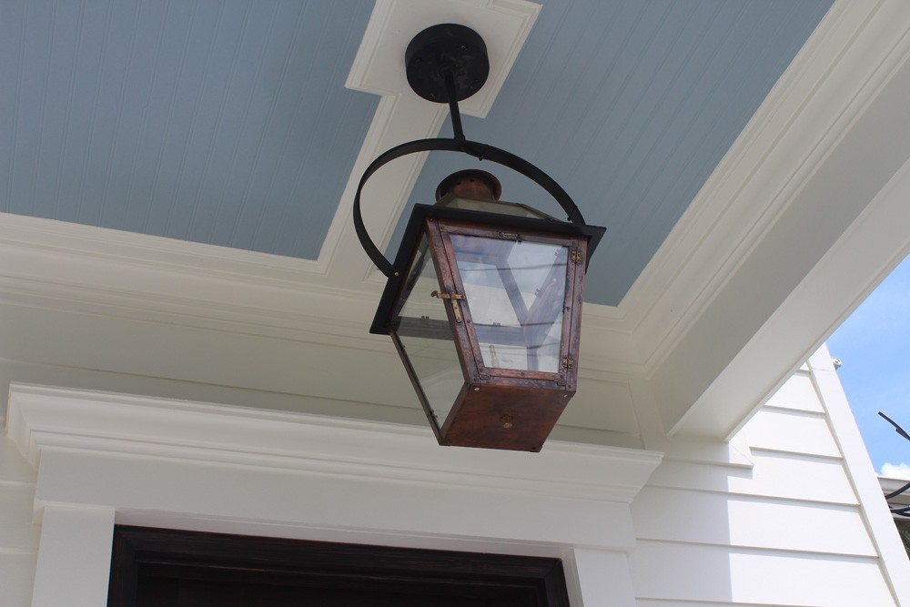 Copper gas lantern mounted on craftsman style trim - Strong Shield